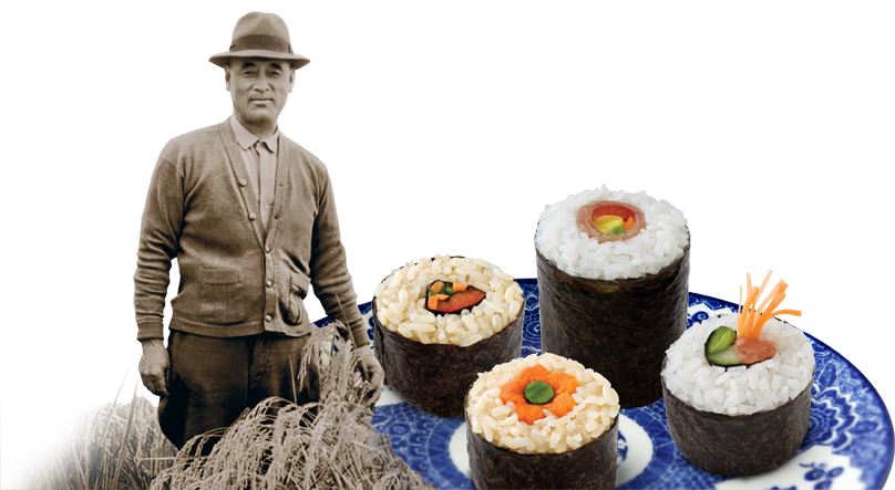 Founder, Keisaburo Koda, Circa 1930s in a rice field next to a plate of sushi.